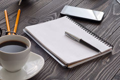 open-notepad-blank-pages-pen-cup-coffee-office-desk-closeup-office-workplace-66724502